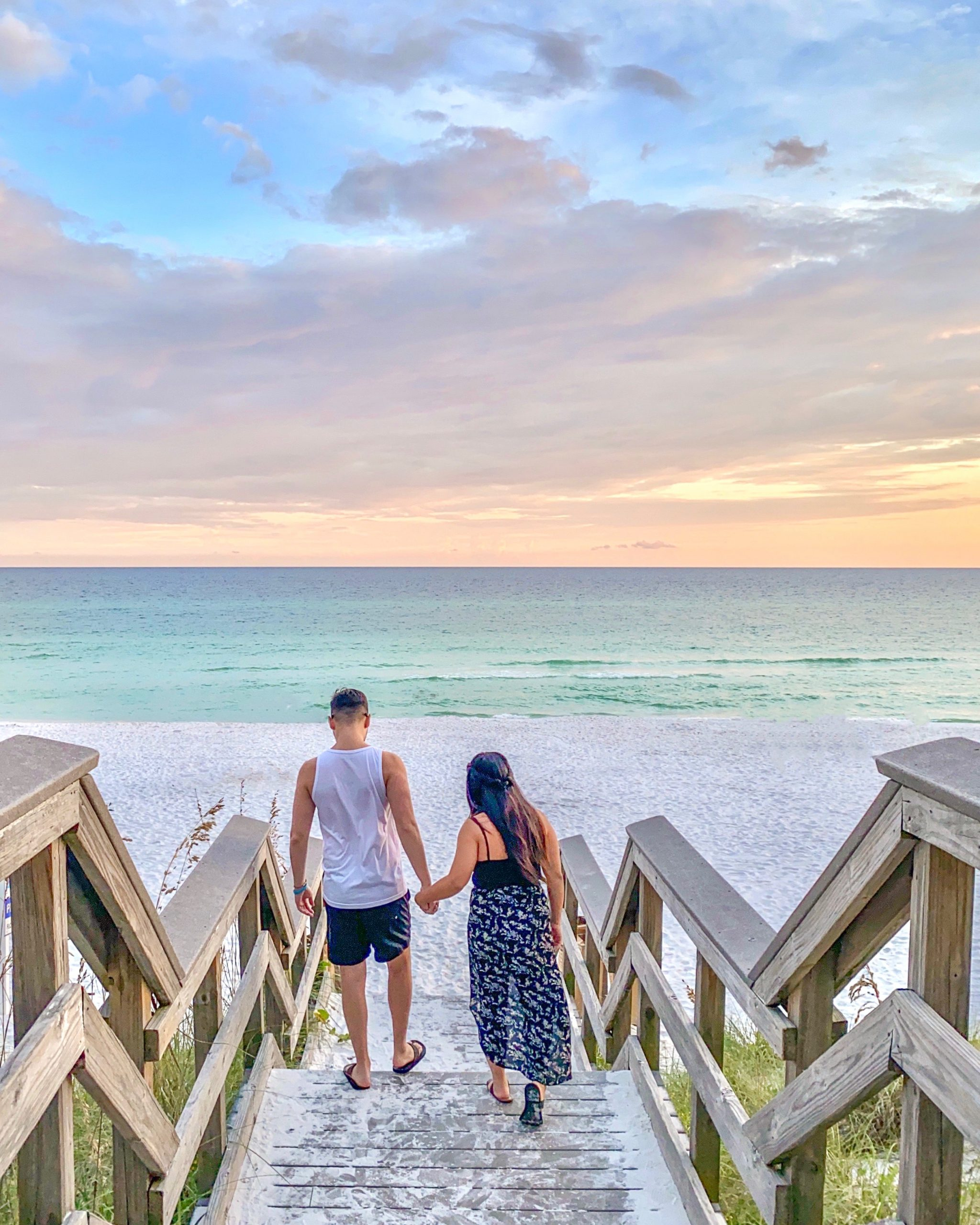 couple at Miramar Beach, Destin during sunset